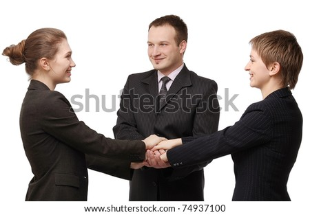 Business people with their handstigether - stock photo