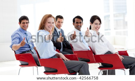 Business people with thumbs up at a conference. Business concept. - stock photo