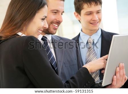 Business people work with the laptop against modern office building - stock photo