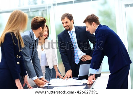Business people working and discussing together at meeting in of - stock photo