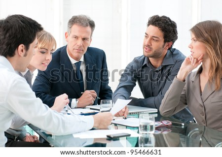 Business people working and discussing together at meeting in office