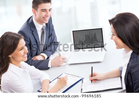 Business people working at a laptop in the office - stock photo