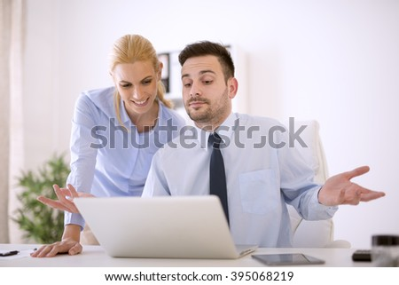 Business people working at meeting in office.They are in discussion while using a laptop. - stock photo