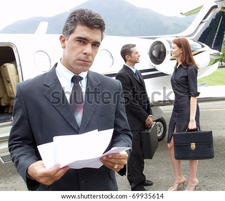 Business people working at private jet. - stock photo