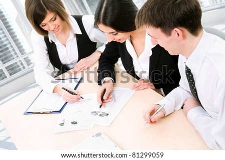 Business people working at the office - stock photo