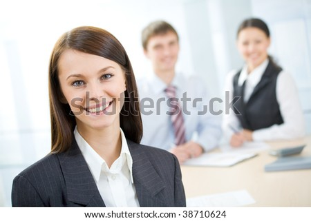 Business people working. Focus is on the woman in front