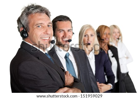 Business people working in a call center standing in a line on white background - stock photo