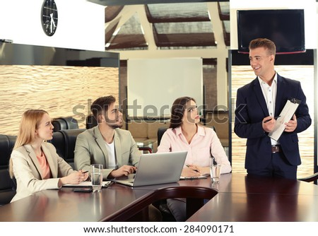 Business people working in conference room - stock photo