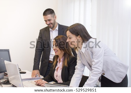 Business people working in group in the office.Young business people working on lap top. Business and office concept