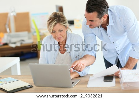 Business people working in office on laptop  - stock photo