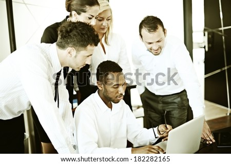Business people working in office with instagram retro filtered effect - stock photo