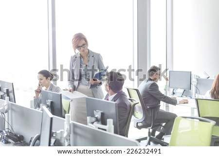 Business people working in open plan office - stock photo