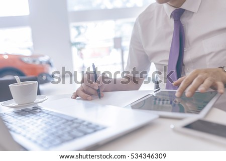 Business people working in the notebook