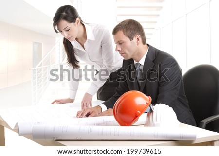 Business people working on blue prints - stock photo