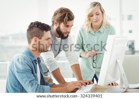 Business people working on computer at office - stock photo