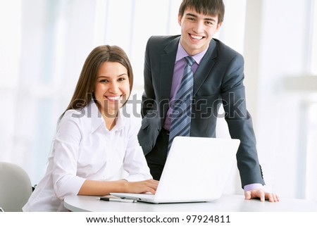 Business people working on laptop computer at office