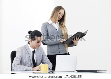 Business people working on laptop, indoor shoot