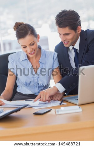 Business people working together and smiling in the office