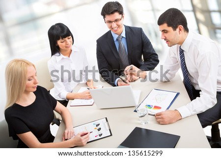 Business people working together in an office - stock photo