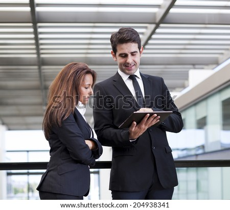Business people working with electronic tablet at modern office bulding - stock photo