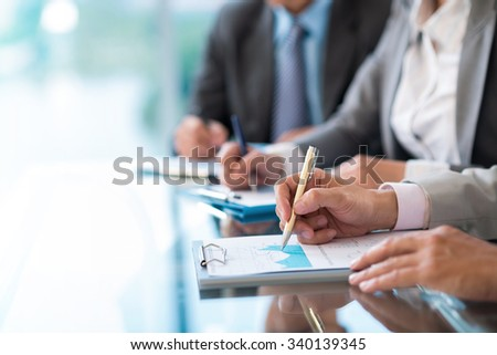 Business people working with financial report at the meeting, selective focus - stock photo