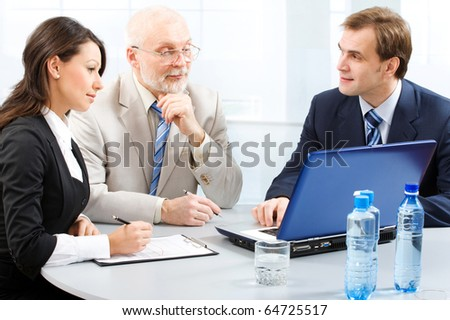 Business people working with lap-top - stock photo