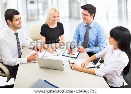 Business people working with laptop in an office