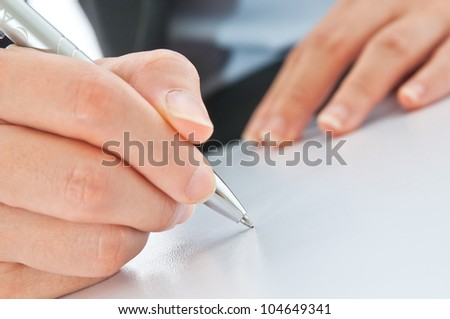 business people writing the pen on blank paper - stock photo