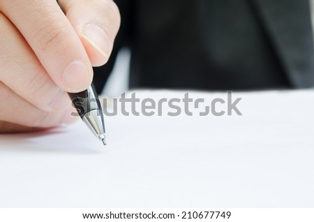 business people writing the pen on blank paper
