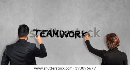 Business people writing the word Teamwork on the screen - stock photo