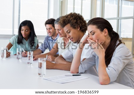 Business people yawning and being bored in the office
