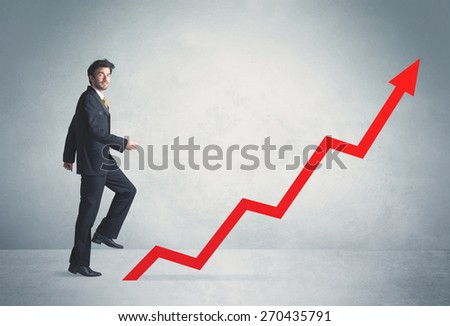 Business person climbing on red graph arrow - stock photo