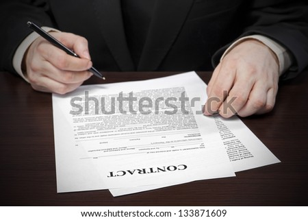 Business person filling document, selective focus image on sign a contract - stock photo