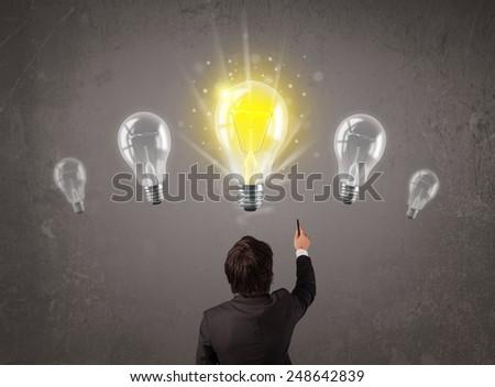 Business person having an bright idea light bulb concept - stock photo