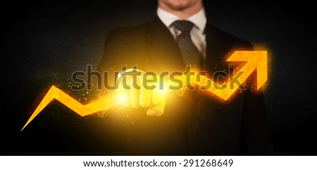 Business person holding a hot glowing upright arrow concept on background - stock photo