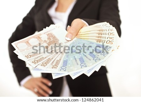 Business person in black suit paying in Euros as a bribe - stock photo