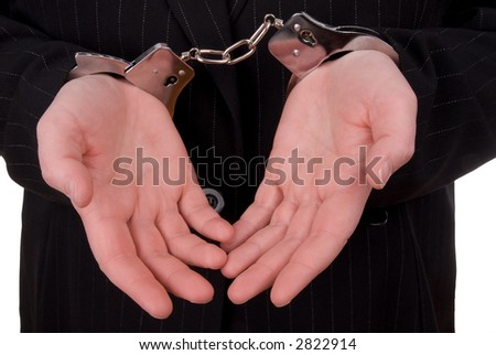 Business person in handcuffs isolated over white - stock photo