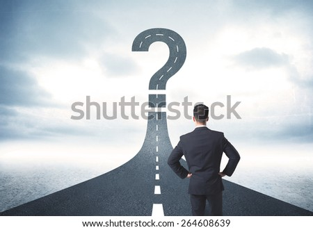Business person lokking at road with question mark sign concept - stock photo