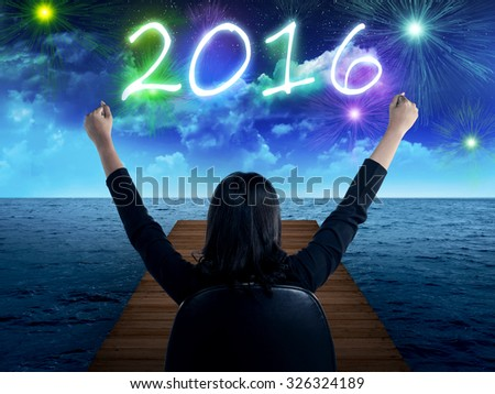 Business person looking to the sea, celebrate 2016 new year - stock photo