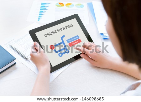Business person makes a purchase through online shopping application on a modern digital tablet