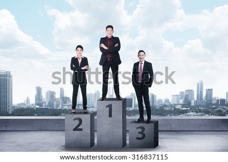 Business person standing on the podium. Business reward concept