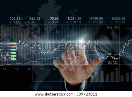 Business person touching charts and diagrams stock market on dark background - stock photo
