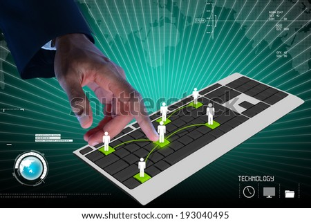 Business person touching digital computer keyboard - stock photo