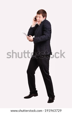business person trying to perform and handle more than one task at the same time. - stock photo