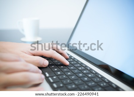 Business person using laptop computer - stock photo