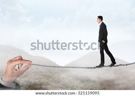 Business person walking on the chain. Business challenge concept