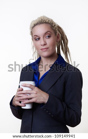 Business person with dreadlock hair holding a take away coffee cup or tea cup to go
