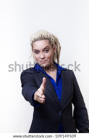 Business person with dreadlock hair holding out hand ready to shake your hand