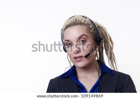 Business person with dreadlock hair on a call at work using a hands free headset device