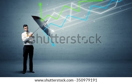 Business person with umbrella and colorful stock market arrows concept - stock photo